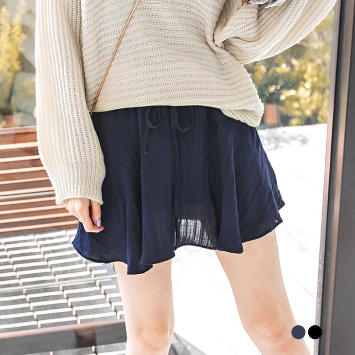 1103新品 純色造型傘擺剪裁抽繩褲裙.2色