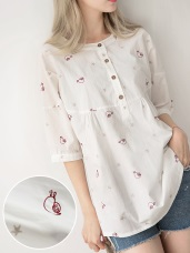 滿版刺繡圖花圓領排釦七分袖襯衫
