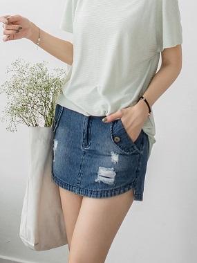 不規則弧襬剪裁抓破設計雙口袋高棉量牛仔短褲裙