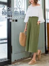 沉穩色調柔感口袋條釦造型闊腿七分寬褲