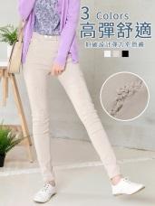 抓破設計鬆緊排釦純色彈力窄管褲