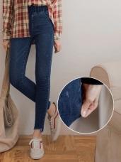 高腰鬆緊自然刷色褲管不規則造型鬚邊窄管褲