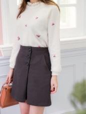 暗色調側釦造型A字包臀裙