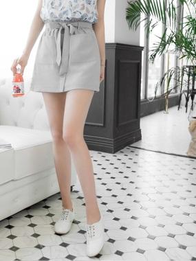 荷葉邊腰綁帶雙口袋排釦造型A字短裙.2色