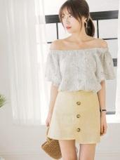 質感純色後腰鬆緊排釦造型不規則裙襬格紋布短裙.2色